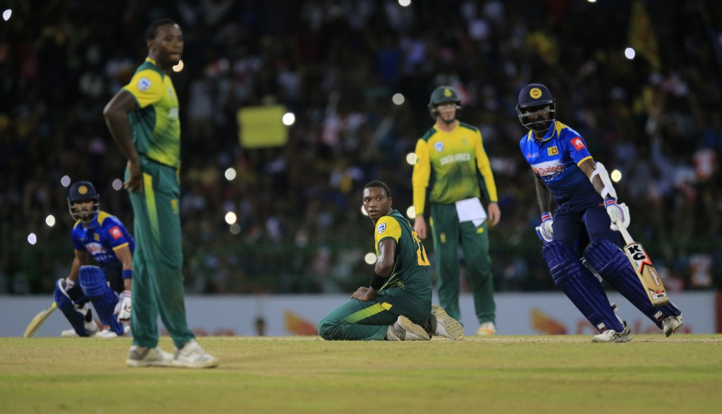 South Africa's Lungi Ngidi, third right, watches Sri Lanka's Dinesh Chandimal, left, and Isuru Udana complete the winning run, defeating South Africa ...