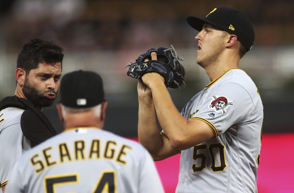Pittsburgh Pirates pitcher Jameson Taillon, right, gets a mound visit with catcher Francisco Cervelli, left, and pitching coach Ray Searage in the fou...