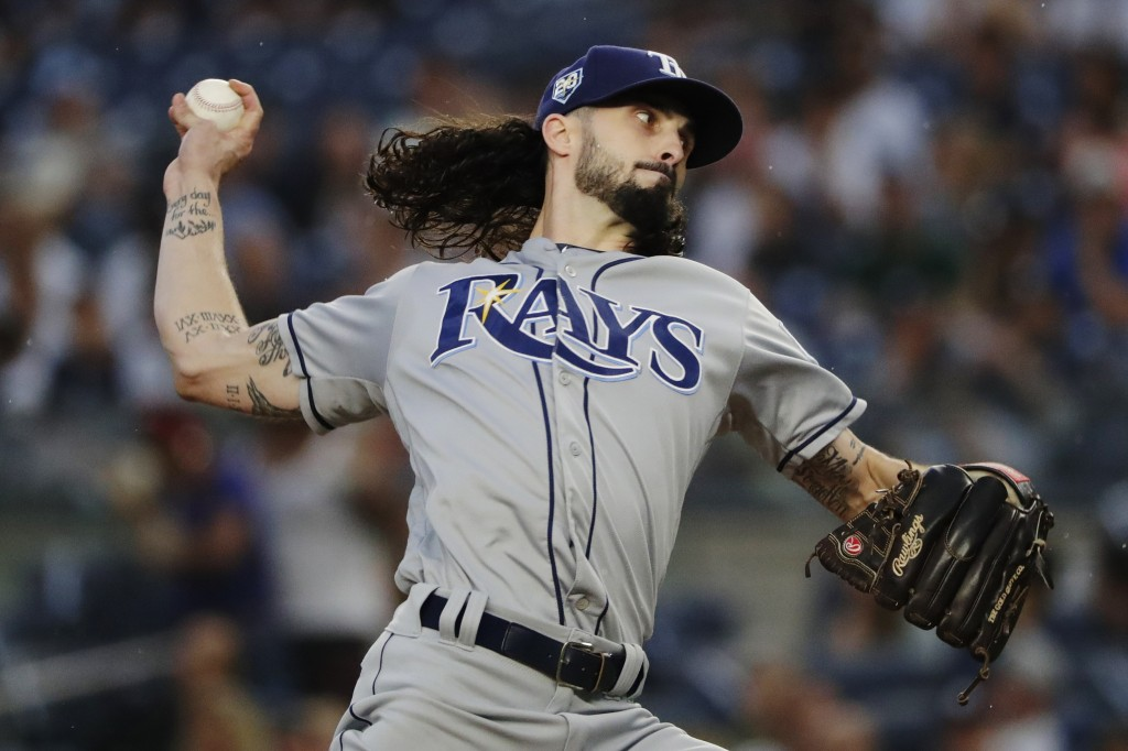 Tampa Bay Rays' Hunter Wood delivers a pitch during the first inning of a baseball game against the New York Yankees Tuesday, Aug. 14, 2018, in New Yo...