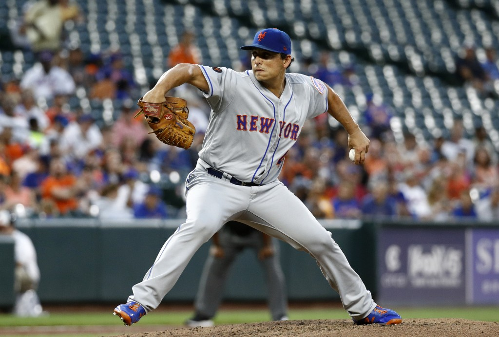 New York Mets starting pitcher Jason Vargas throws to the Baltimore Orioles in the third inning of a baseball game, Tuesday, Aug. 14, 2018, in Baltimo...