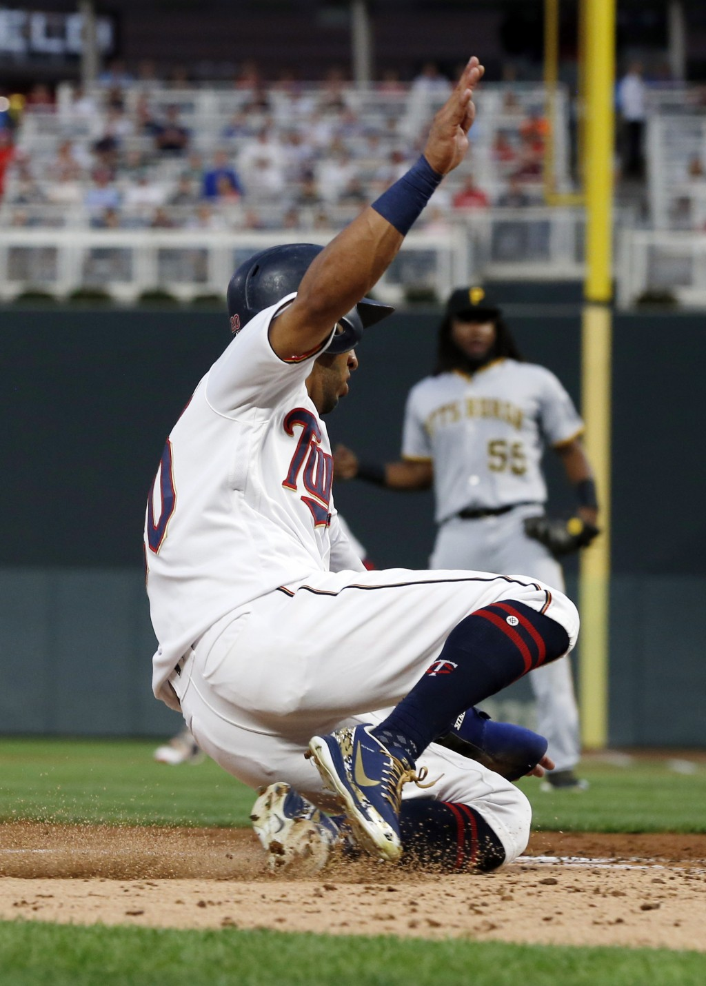 Minnesota Twins' Eddie Rosario slides in to score on a single by Jorge Polanco off Pittsburgh Pirates pitcher Jameson Taillon in the fourth inning of ...