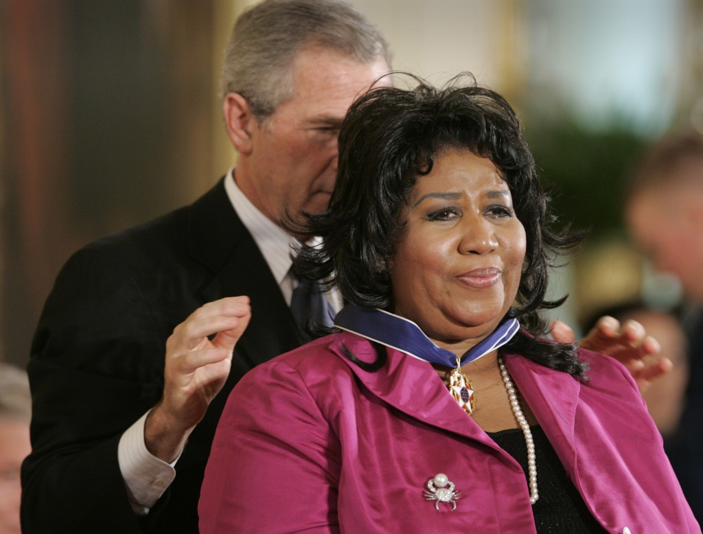 FILE - In this Nov. 9, 2005 file photo, President George W. Bush awards singer Aretha Franklin the Presidential Medal of Freedom Award, the highest ci...