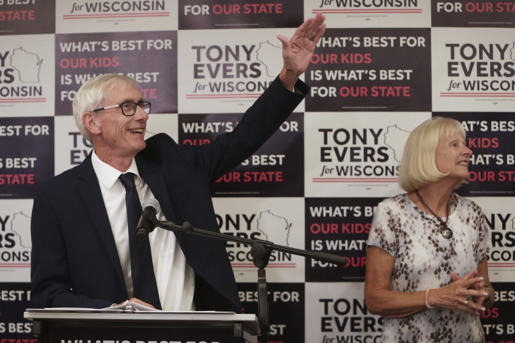 Tony Evers, with his wife, Kathy, speaks after his win in Wisconsin's Democratic gubernatorial primary election during an event at Best Western Premie...
