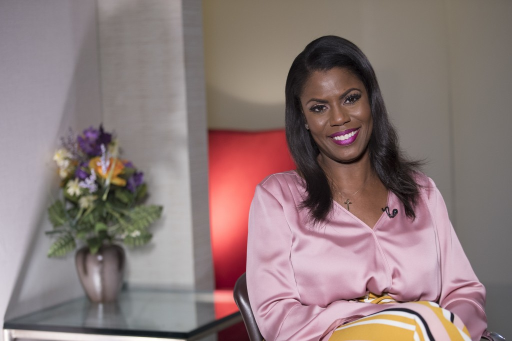 Television personality and former White House staffer Omarosa Manigault Newman smiles during an interview with The Associated Press, Tuesday, Aug. 14,...