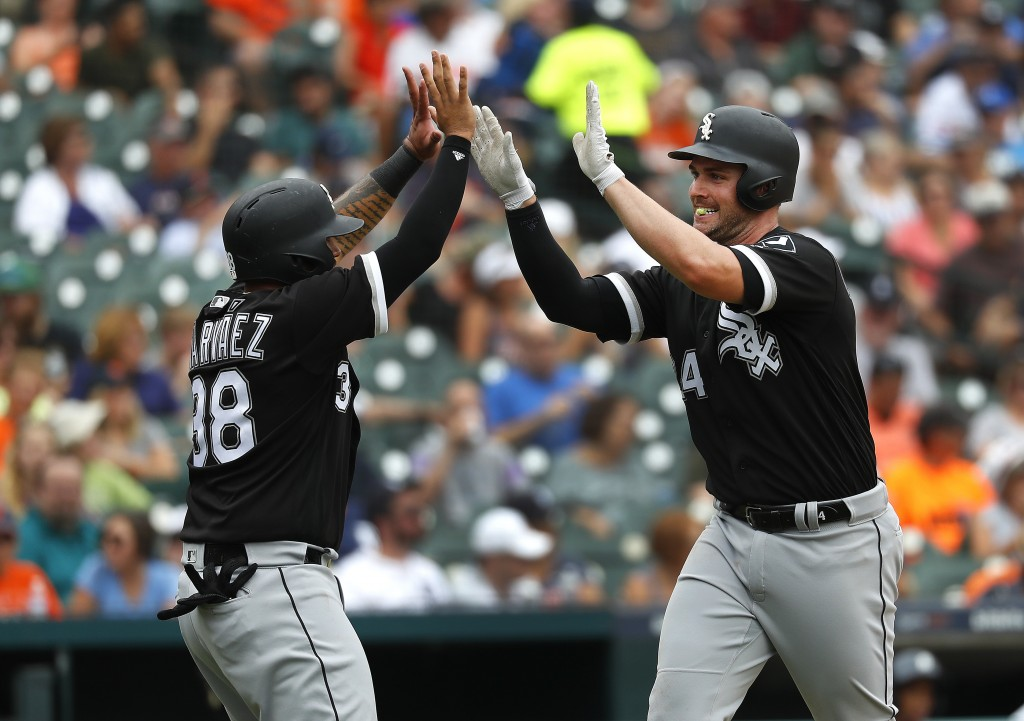 Chicago White Sox's Matt Davidson, right, celebrates hitting a two-run home run with Omar Narvaez (38) in the fourth inning of a baseball game against...