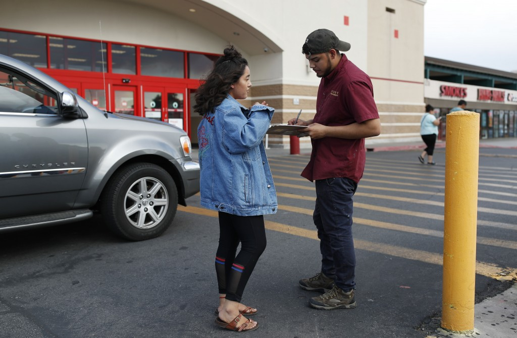In this Aug. 15, 2018, photo, Jazmin Cortez, left, registers Victor Arias to vote in Las Vegas. Democrats in Nevada are working to register and engage...