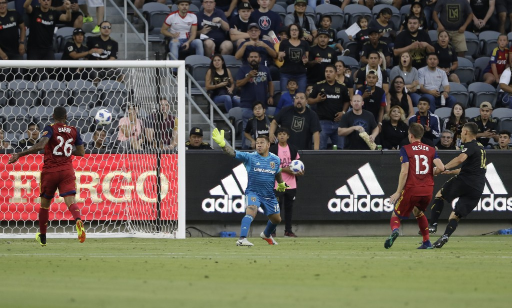 Real Salt Lake goalkeeper Nick Rimando, center, gives up a goal on a head ball by Los Angeles FC's Christian Ramirez, right, during the first half of ...