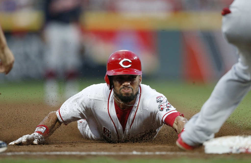 Cincinnati Reds' Billy Hamilton slides safely into third base as he advances on a wild pitch by Cleveland Indians starter Shane Bieber during the seco...