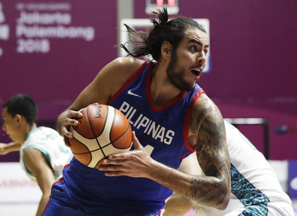 Philippines' Christian Standhardinger drives to the basket during their men's basketball match against Kazakhstan at the 18th Asian Games in Jakarta, ...