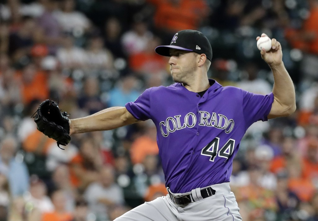 Colorado Rockies starting pitcher Tyler Anderson throws to a Houston Astros batter during the first inning of a baseball game Wednesday, Aug. 15, 2018...