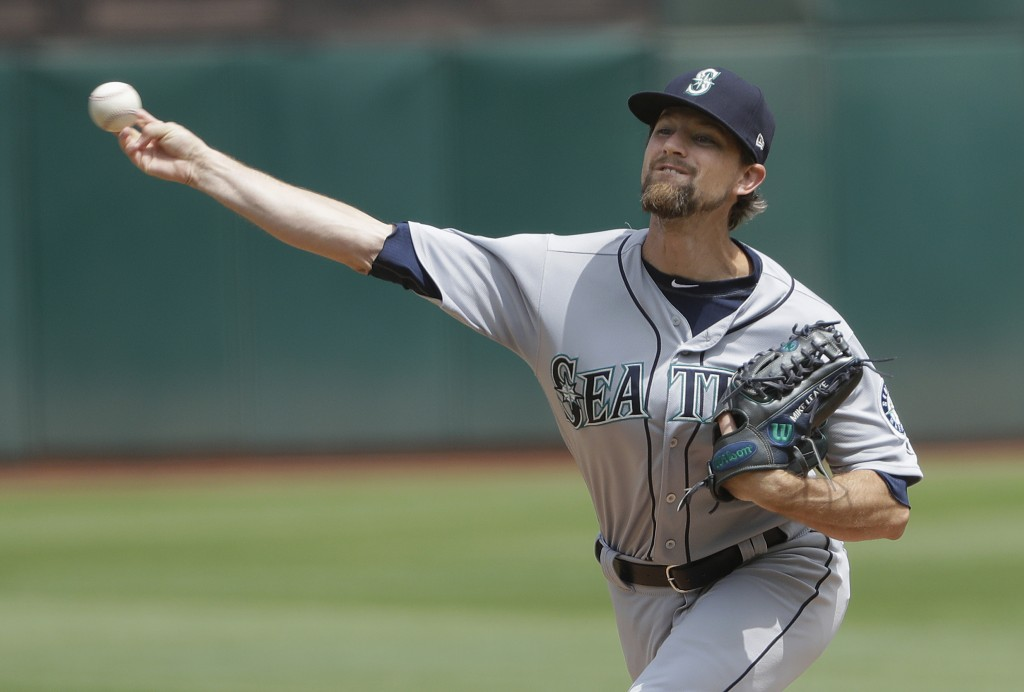 Seattle Mariners pitcher Mike Leake throws against the Oakland Athletics during the first inning of a baseball game in Oakland, Calif., Wednesday, Aug...