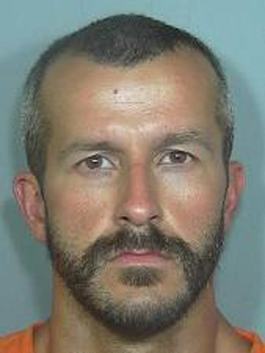 This booking photo from the Weld County Sheriff's Office shows Chris Watts. Authorities say Watts, the husband of a missing family in Colorado has bee...