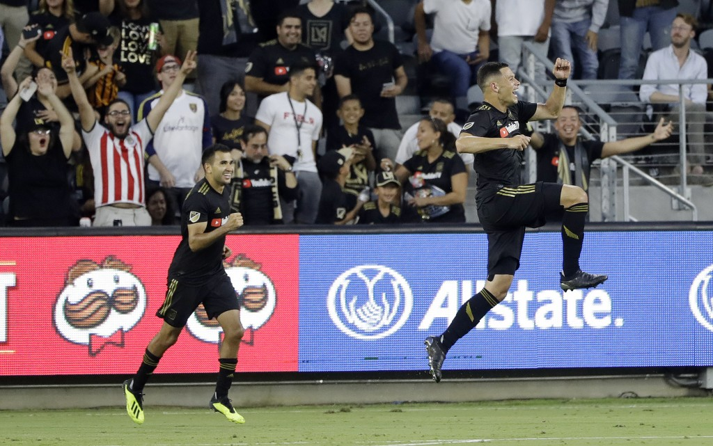 Los Angeles FC's Christian Ramirez, right, celebrates after scoring against Real Salt Lake during the first half of an MLS soccer match Wednesday, Aug...