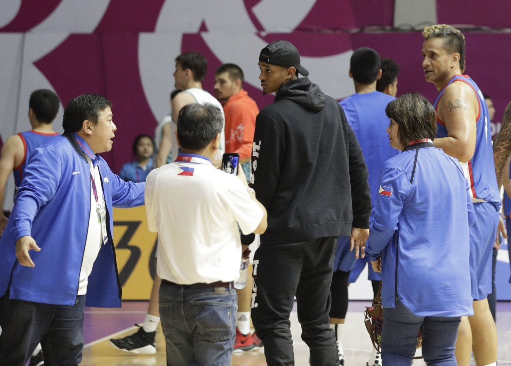 Filipino-American NBA player Jordan Clarkson, center, walks after the game Kazakhstan at the men's basketball match at the 18th Asian Games in Jakarta...