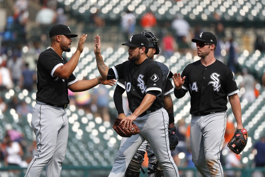 Chicago White Sox's Jose Abreu, from left, Luis Avilan and Matt Davidson celebrate their 6-5 win against the Detroit Tigers after a baseball game in D...
