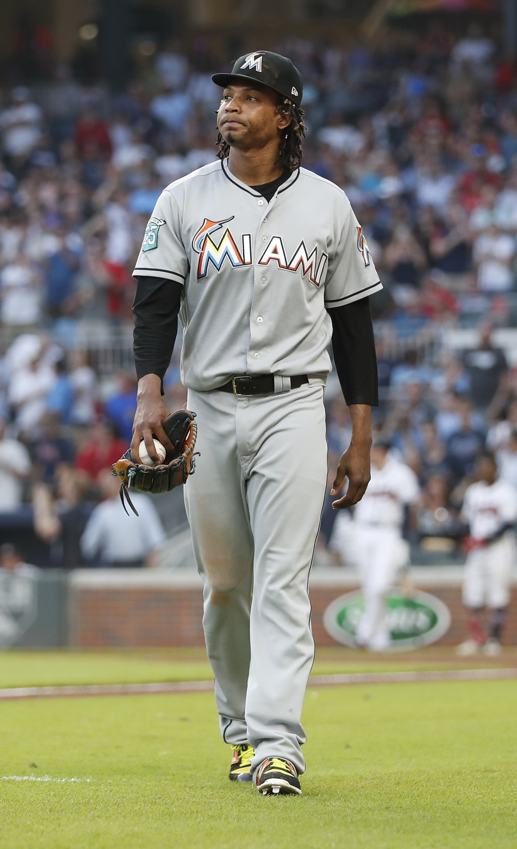 Miami Marlins starting pitcher Jose Urena leaves the field after being ejected for hitting Atlanta Braves' Ronald Acuna Jr. with a pitch during the fi...