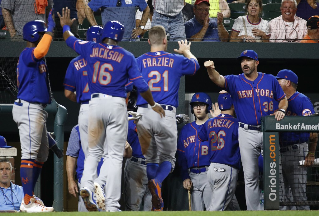 New York Mets manager Mickey Callaway, right, greets Todd Frazier (21) after Frazier scored on Kevin Plawecki's grand slam during the sixth inning of ...