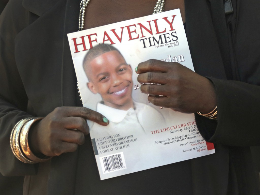 FILE - In this May 6, 2017 file photo, mourners hold the commemorative program as they emerge from the funeral service for 15-year-old, Jordan Edwards...