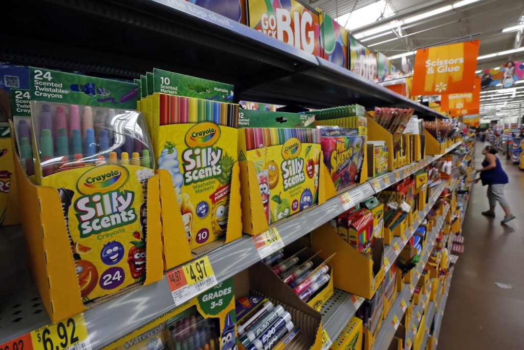 FILE- This July 19, 2018, file photo shows a display of scented markers and crayons in a Walmart in Pittsburgh. Walmart Inc. reports earnings on Thurs...