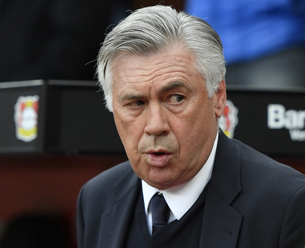 FILE - In this April 15, 2017 fiel photo Bayern head coach Carlo Ancelotti arrives to the German Bundesliga soccer match between Bayer Leverkusen and ...