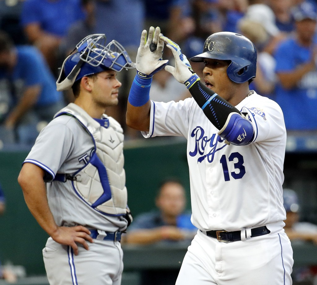 Kansas City Royals' Salvador Perez crosses the plate in front of Toronto Blue Jays catcher Luke Maile after hitting a two-run home run during the firs...