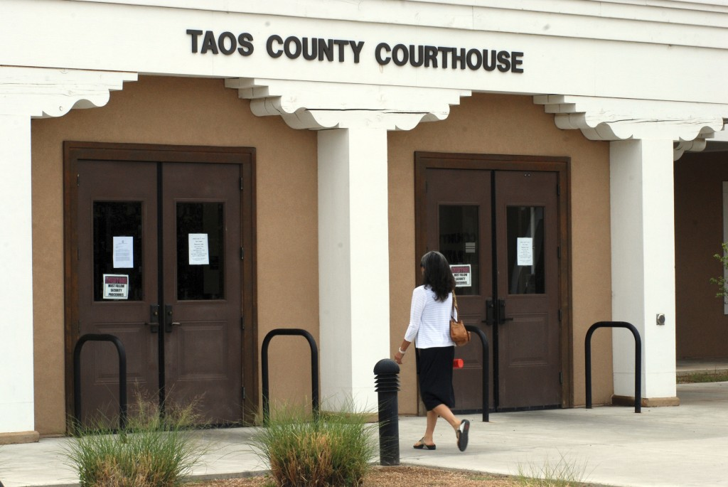 The Taos County Courthouse, where three people accused of child abuse at a desert compound are awaiting release, is shown Wednesday, Aug. 15, 2018, in...