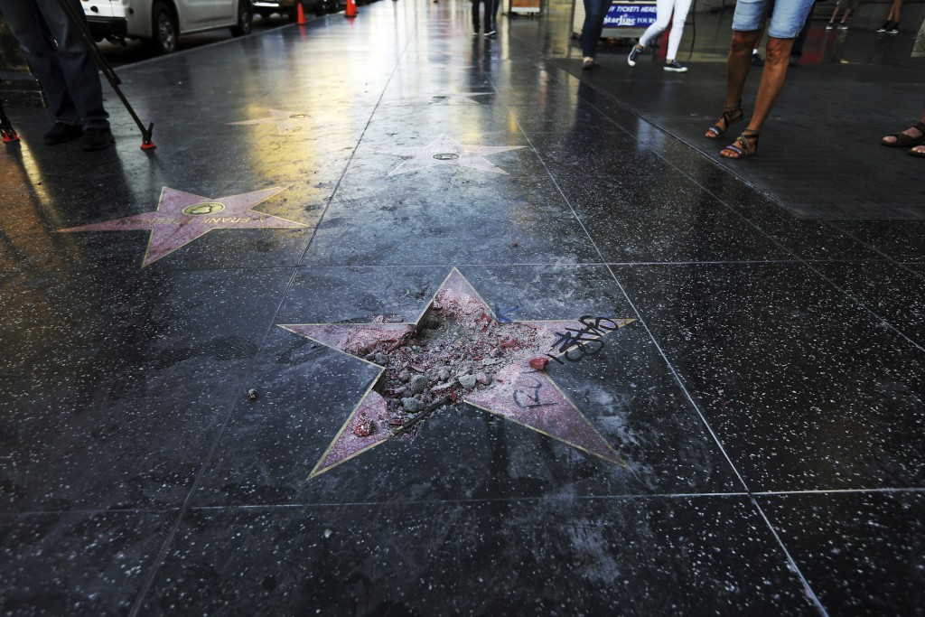 FILE - This photo July 25, 2018 file photo shows Donald Trump's star on the Hollywood Walk of Fame that was vandalized, in Los Angeles. The man accuse...