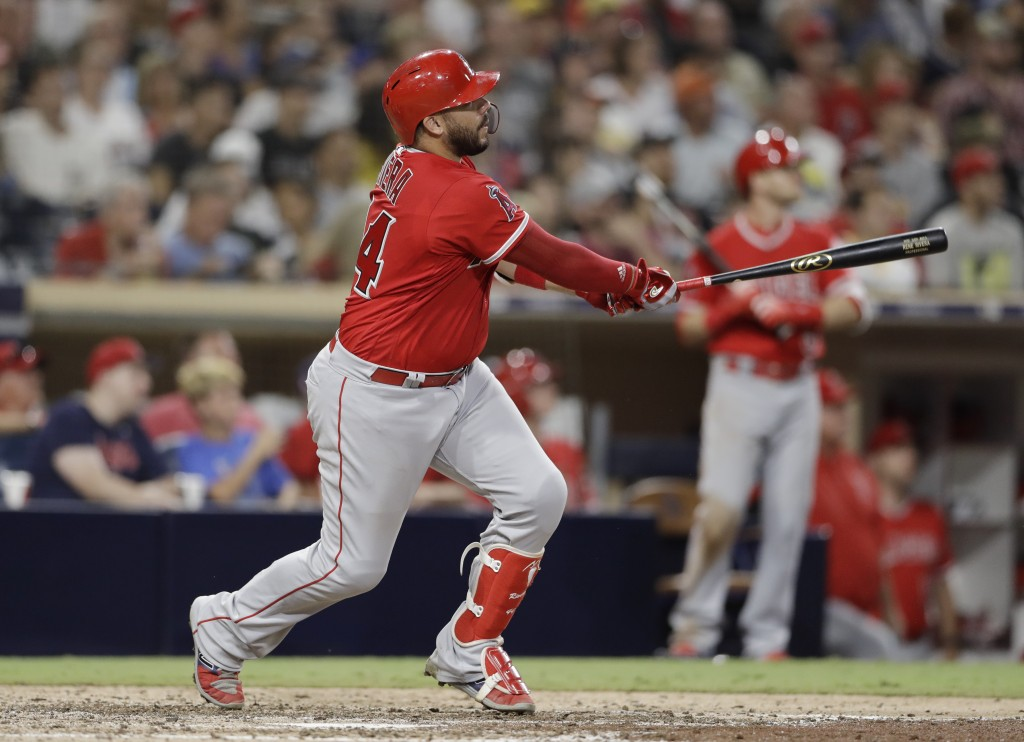 Los Angeles Angels' Rene Rivera watches his home run during the ninth inning against the San Diego Padres in a baseball game Wednesday, Aug. 15, 2018,...