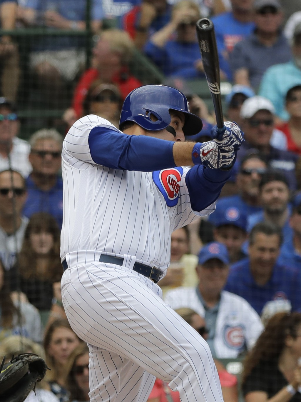 Chicago Cubs' Anthony Rizzo hits a two-run home run against the Milwaukee Brewers during the first inning of a baseball game Wednesday, Aug. 15, 2018,...
