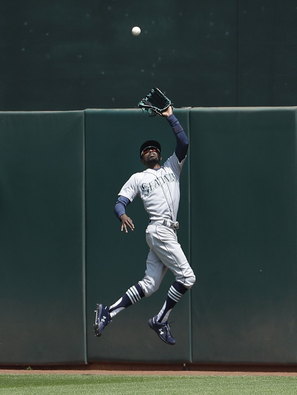 Seattle Mariners center fielder Dee Gordon catches a fly ball hit by Oakland Athletics' Stephen Piscotty during the fifth inning of a baseball game in...