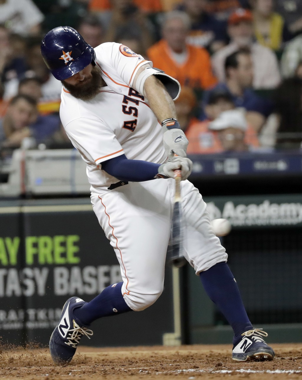 Houston Astros' Tyler White hits a two-run home run against the Colorado Rockies during the fifth inning of a baseball game Wednesday, Aug. 15, 2018, ...
