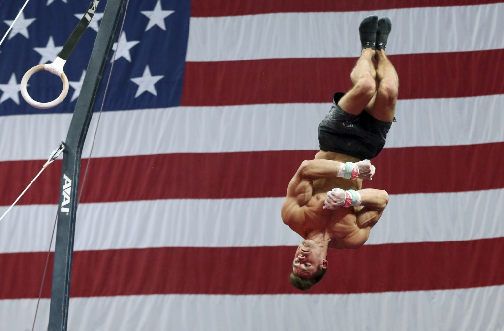 Sam Mikulak practices on the rings during a training session at the U.S. Gymnastics Championships, Wednesday, Aug. 15, 2018, in Boston. (AP Photo/Elis...