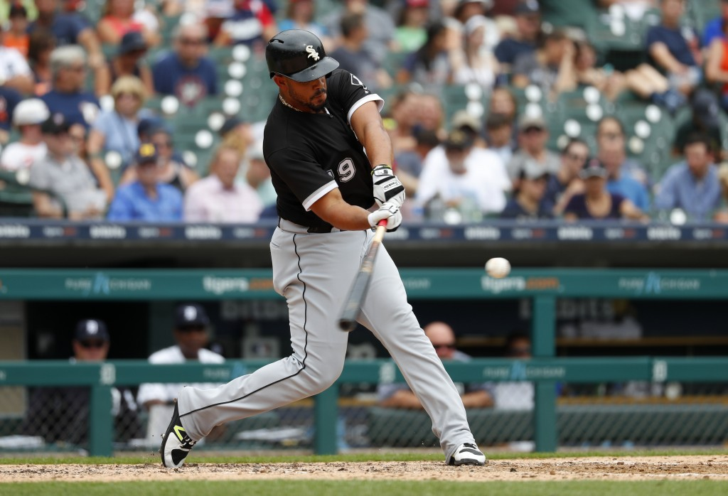 Chicago White Sox's Jose Abreu hits a two-run home run in the fifth inning of a baseball game against the Detroit Tigers in Detroit, Wednesday, Aug. 1...