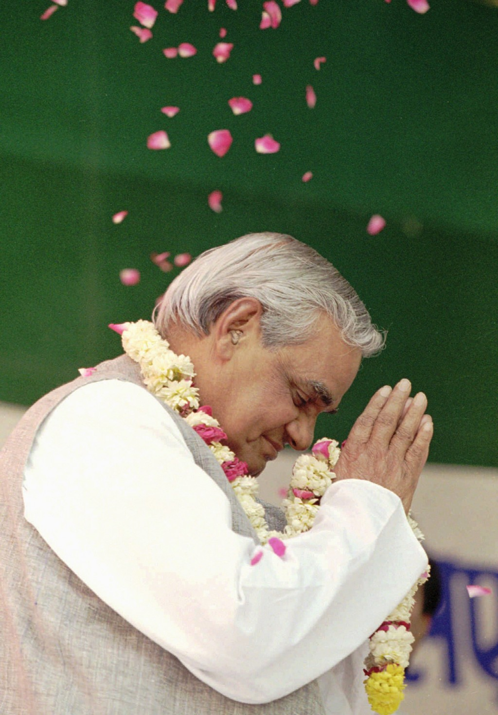 FILE - In this April 25, 1996 file photo, the Hindu nationalist party candidate for Prime Minister Atal Bihari Vajpayee greets supporters and is showe...