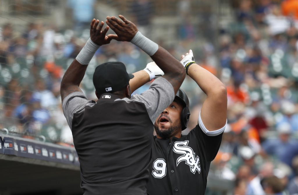 Chicago White Sox's Jose Abreu (79) celebrates his two-run home run with Tim Anderson in the fifth inning of a baseball game against the Detroit Tiger...