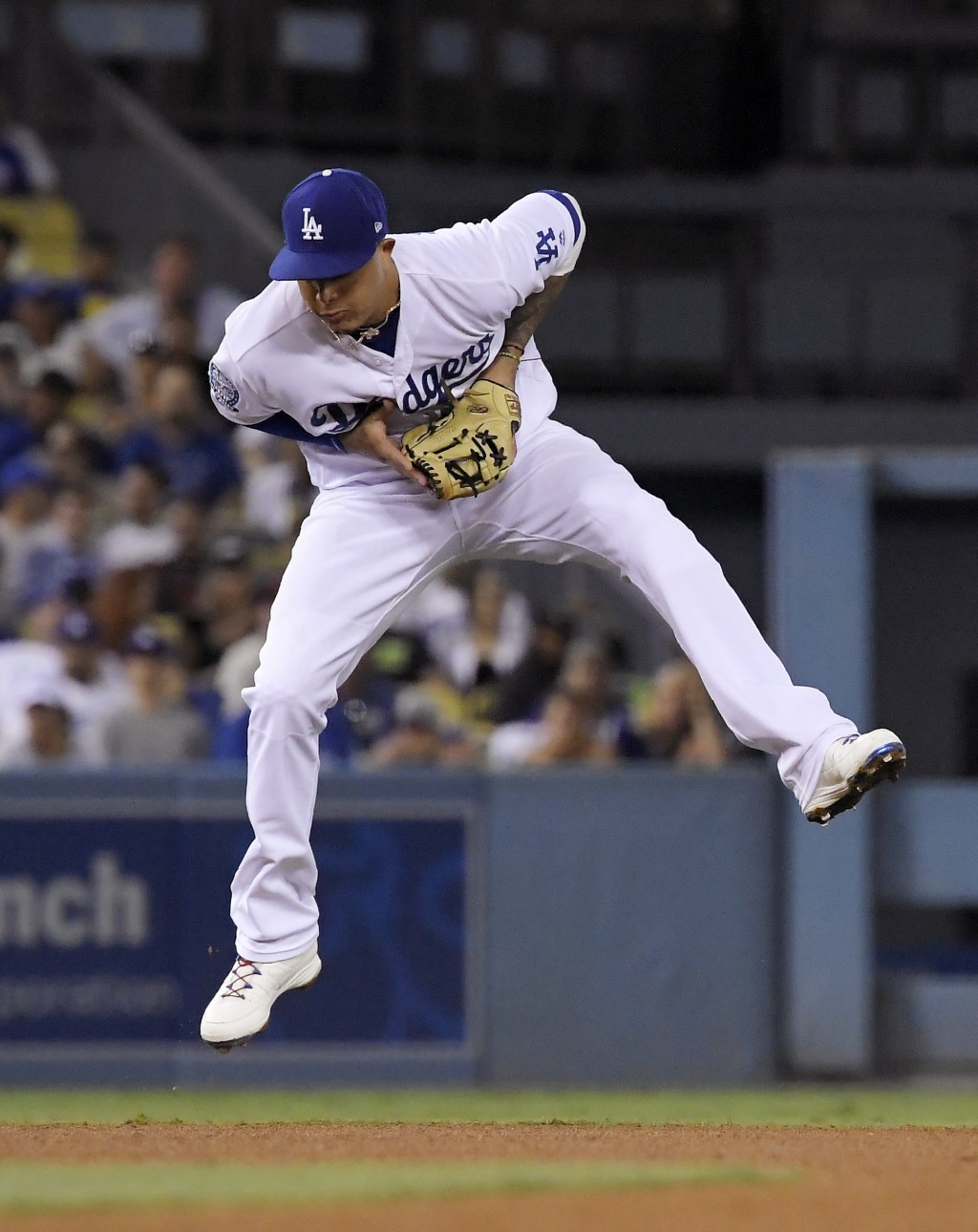 Los Angeles Dodgers shortstop Manny Machado fields a ball hit by San Francisco Giants' Buster Posey during the fourth inning of a baseball game Wednes...