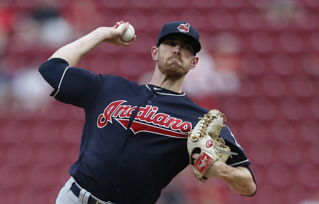 Cleveland Indians starting pitcher Shane Bieber throws to a Cincinnati Reds batter during the first inning of a baseball game Wednesday, Aug. 15, 2018...