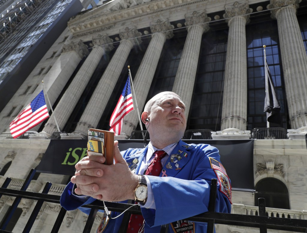 FILE- In this April 26, 2018, file photo, Vincent Pepe enjoys some fresh air outside the New York Stock Exchange where he works trading cotton shares ...
