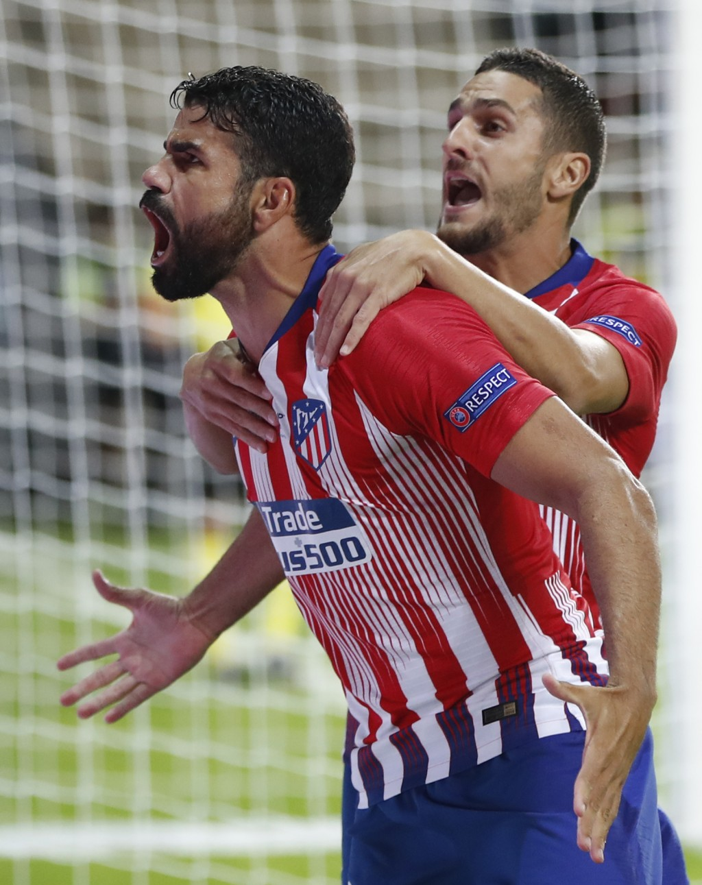 Atletico's Diego Costa, left, celebrates with teammate Atletico's Koke, right, after scoring his sides first goal during the UEFA Super Cup final socc...