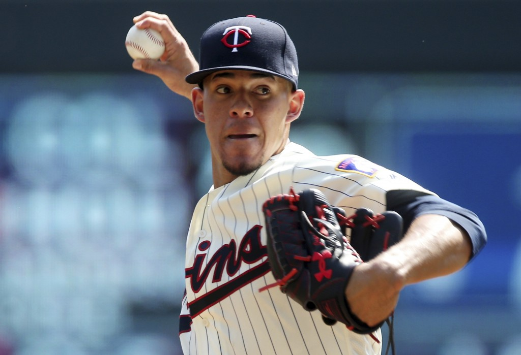 Minnesota Twins pitcher Jose Berrios throws against the Pittsburgh Pirates in the first inning of a baseball game Wednesday, Aug. 15, 2018, in Minneap...