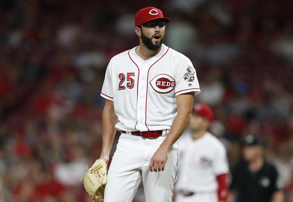 Cincinnati Reds relief pitcher Cody Reed reacts to giving up a two-run home run to Cleveland Indians' Melky Cabrera during the sixth inning of a baseb...