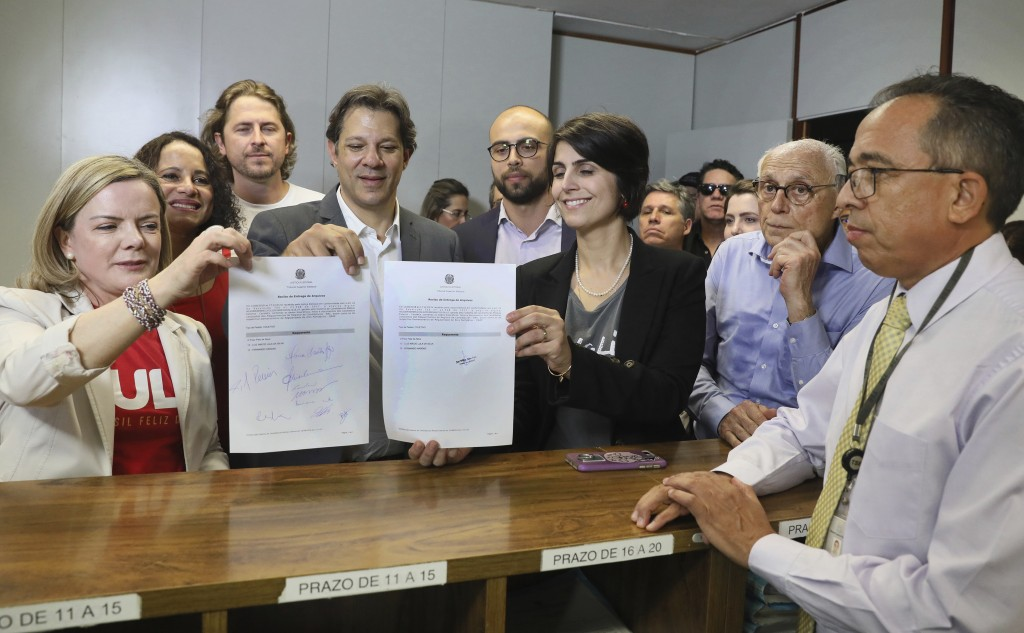 In this photo released by the Supreme Electoral Court, from left, Worker's Party President Senator Gleisi Hoffmann, former Sao Paulo Mayor Fernando Ha...