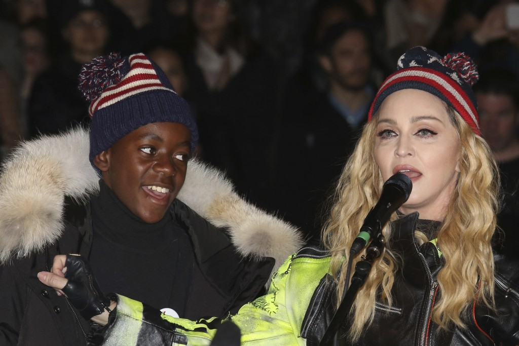 FILE- In this Nov 7, 2016 file photo, U.S. Singer Madonna, right, and her son David Banda perform in support of Democratic presidential candidate Hill...