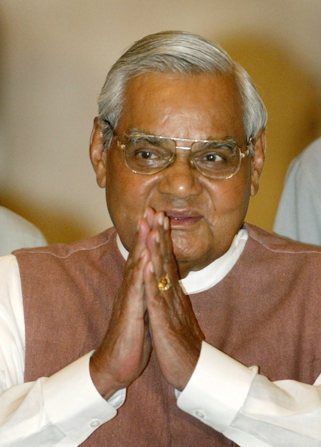 FILE - In this May 2, 2004 file photo, Indian Prime Minister Atal Bihari Vajpayee greets the audience as he arrives for a ceremony at the Presidential...