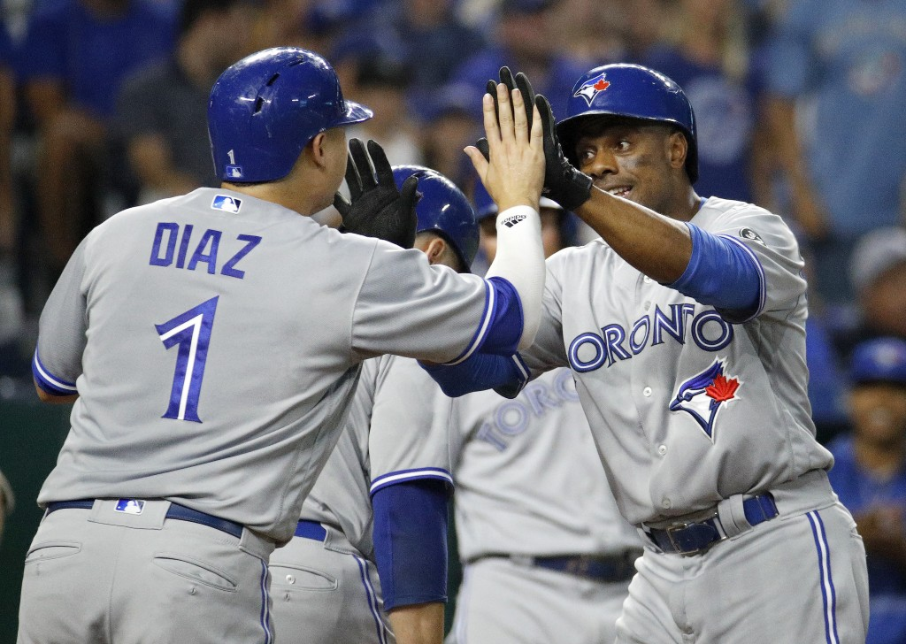 Toronto Blue Jays' Curtis Granderson, right, celebrates with Aledmys Diaz (1) after hitting a grand slam during the fourth inning of a baseball game a...
