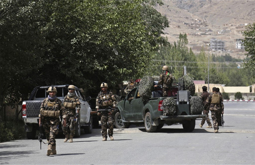 Afghan security forces arrive at the site of an attack by gunmen, in Kabul, Afghanistan, Thursday, Aug. 16, 2018. Gunmen besieged a compound belonging...
