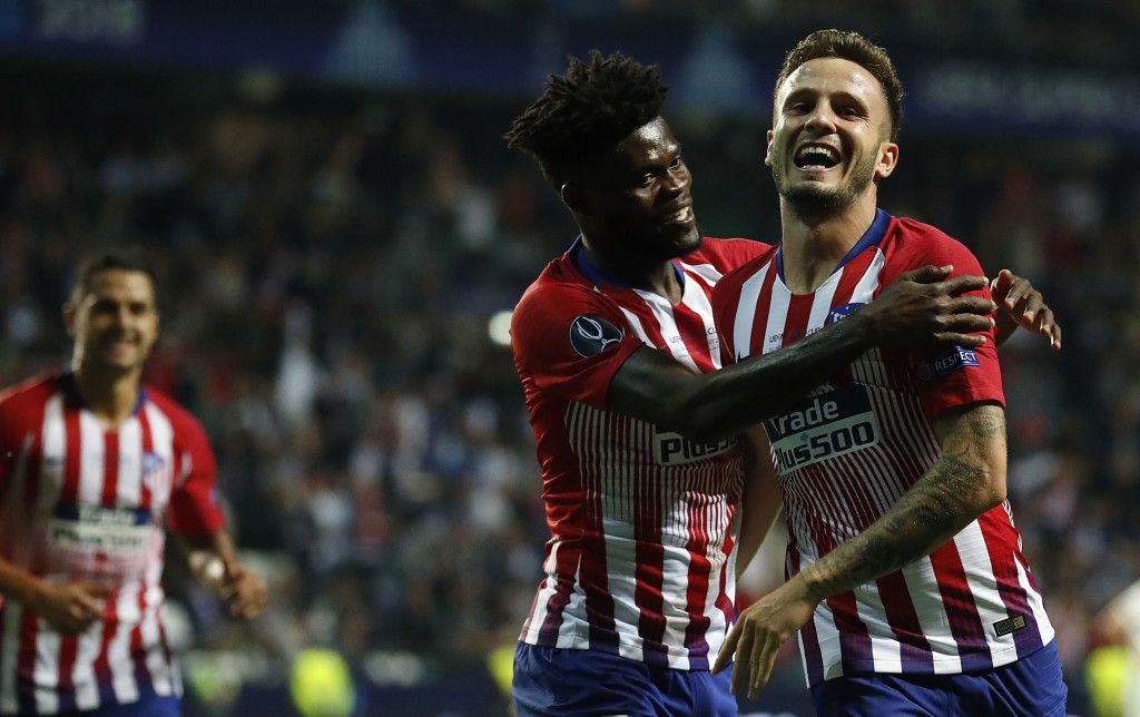 Atletico's Saul Niguez, right, celebrates after scoring his side's third goal during the UEFA Super Cup final soccer match between Real Madrid and Atl...