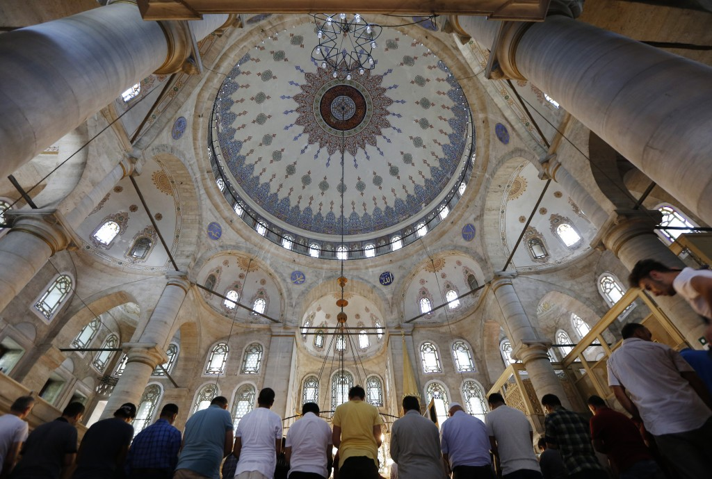 People pray in a mosque in Istanbul, Wednesday, Aug. 15, 2018. The Turkish government's framing of its problems as an epic battle for sovereignty agai...