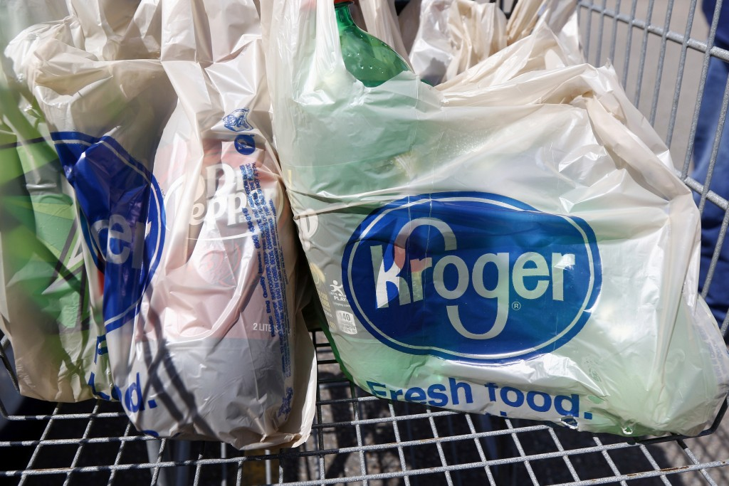 FILE- This June 15, 2017, file photo shows bagged purchases from the Kroger grocery store in Flowood, Miss. Kroger Co. has chosen a Phoenix suburb as ...