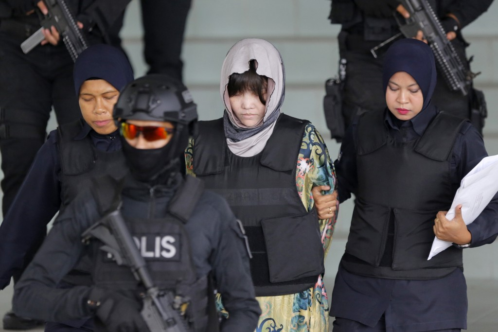 In this Aug. 16, 2018, photo, Vietnamese Doan Thi Huong, center, is escorted by police as she leaves her court hearing at the Shah Alam High Court in ...